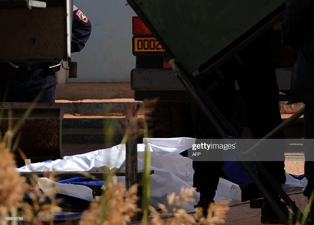 Body bags of victims that were killed during the hostage crisis at a desert gas plant in Algeria's deep south are seen after they were unloaded from a refrigerated truck in In Amenas that is transporting the bodies to hospital for identification on January 21, 2012. Two days after Algerian forces ended a hostage crisis at a desert gas plant, the exact toll of those killed in the bloodbath remained unknown, amid fears the total number of hostages who died could reach 50.