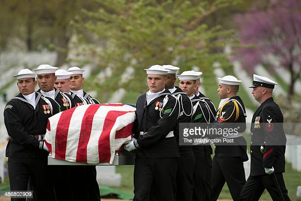 Body bearers with the United States Navy Ceremonial Guard carry the casket during the memorial service for United States Navy MasteratArms 2nd Class...