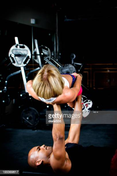 Body Builder BenchPressing A Fit Woman