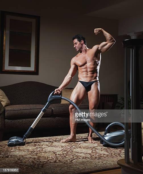 Body builder vacuuming