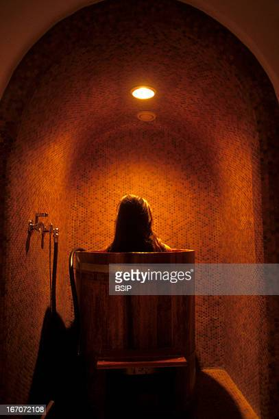 Body care woman Natural spa in Austria Kneip treatment which alternates hot and cold temperatures