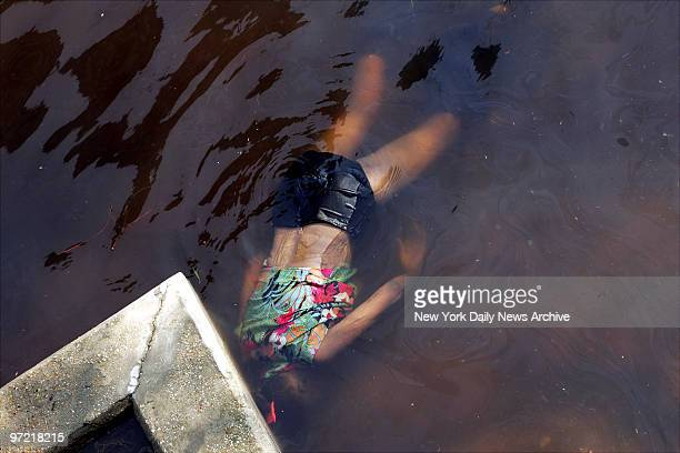 A body floats in brackish water in the flooded street outside New Orleans' Superdome where thousands of people took shelter after the submerged city...