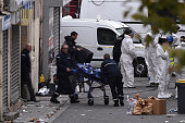A body is removed from the apartment raided by French Police special forces earlier in the northern Paris suburb of SaintDenis on November 18 hunting...