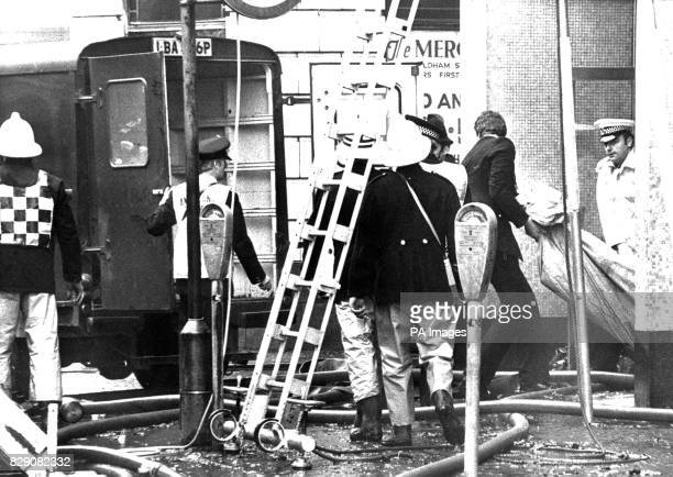 A body is removed from the Woolworth store in Picacadilly Manchester where ten people died in a major blaze