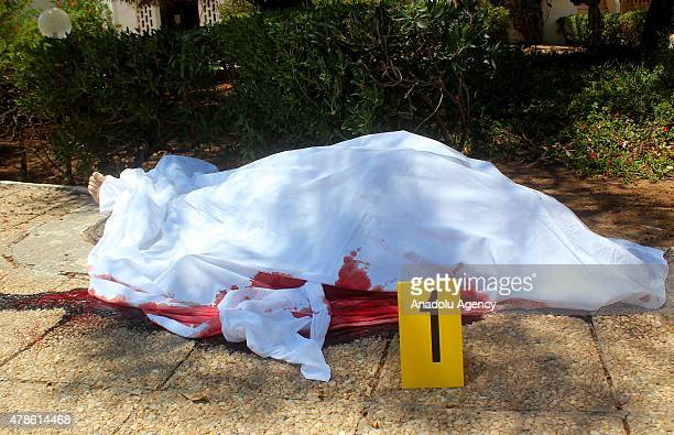 A body is seen after an armed attack on a tourist hotel in Sousse east Tunisia left at least 27 people dead including foreigners and injured six...