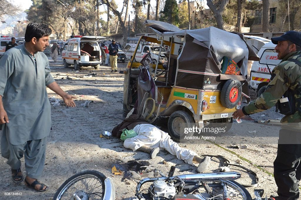 A body is seen at the site of a suicide attack in Quetta, Pakistan, on February 6, 2016. At least nince people were killed and several others wounded in the suicide attack near the premises of the heavily guarded Quetta district courts on Saturday.