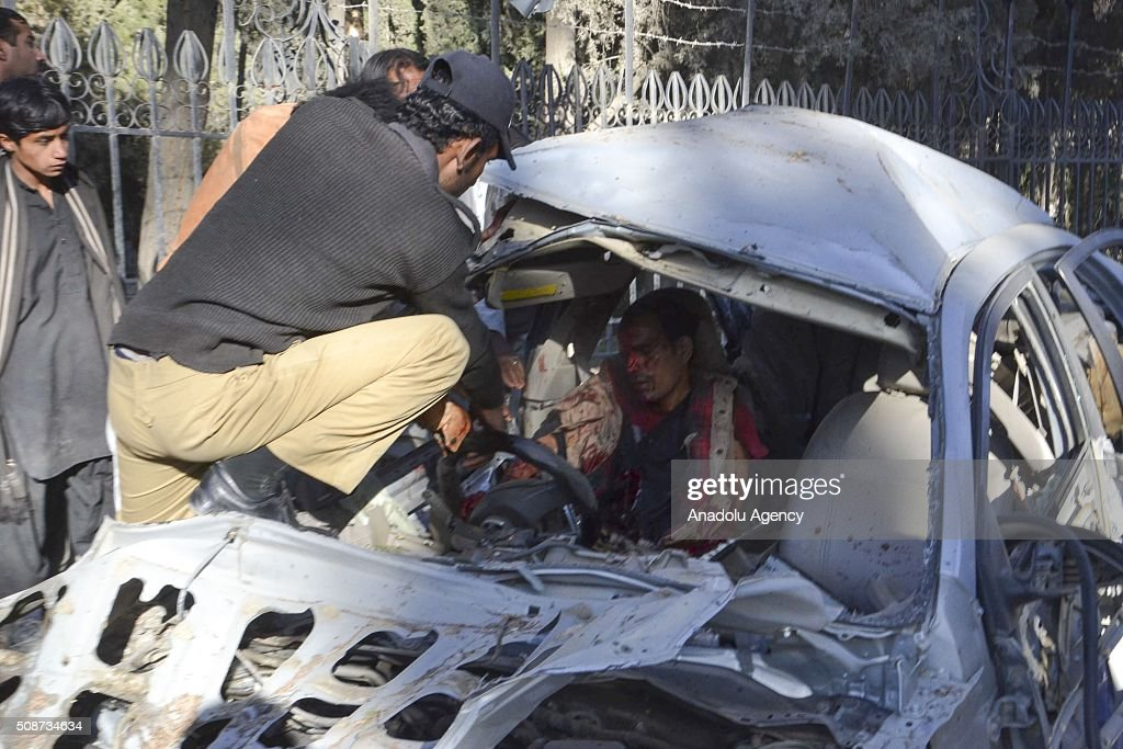 A body is seen in a vehicle at the site of a suicide attack in Quetta, Pakistan, on February 6, 2016. At least nince people were killed and several others wounded in the suicide attack near the premises of the heavily guarded Quetta district courts on Saturday.