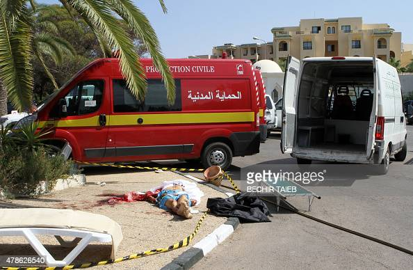 A body is seen on the ground in the resort town of Sousse a popular tourist destination 140 kilometres south of the Tunisian capital on June 26...