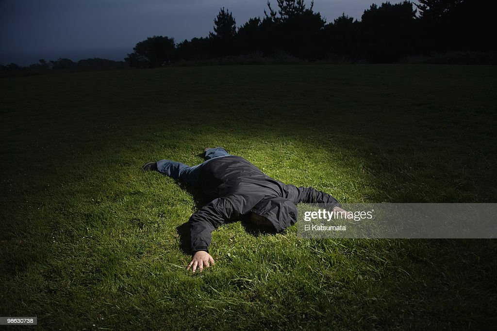 Body laying on grass : Stock Photo
