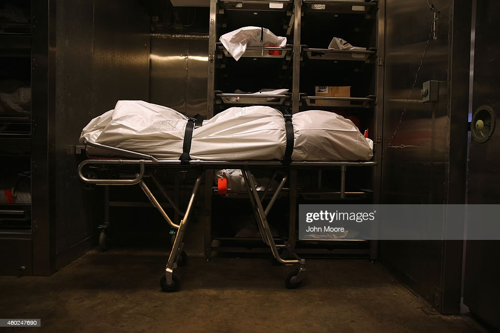 A body lies in the morgue at the Pima County Office of the Medical Examiner on December 9 2014 in Tucson Arizona Forensic anthropologists attempt to...