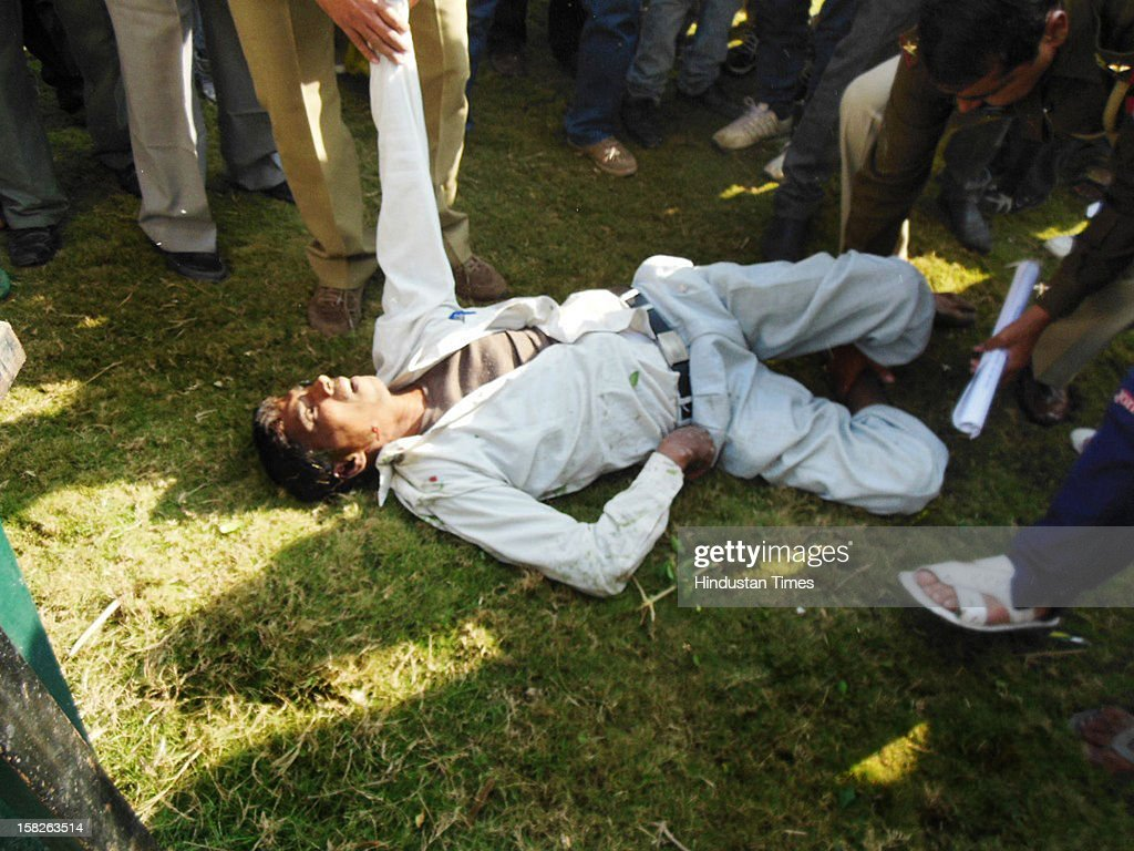 Body of a 38 year old man who jumped off from a water-tank at Vijay Nagar as police and locals looked on Victim was later declared dead on December 12, 2012 in Ghaziabad, India.