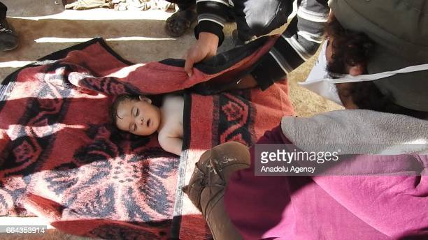 Body of a baby is seen after a suspected chlorine gas attack by Assad Regime forces to Khan Shaykhun town of Idlib Syria on April 4 2017
