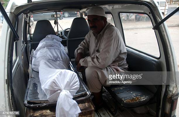 A body of a heatwave victim is being transported from a hospital in Karachi Pakistan on July 3 2015 A Pakistani official says the devastating...