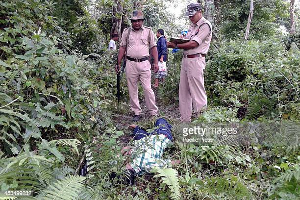 Body of a rhino poacher killed by the personnel of Assam Forest Department who recovered arms and ammunition during an encounter at Agora Toli Range...