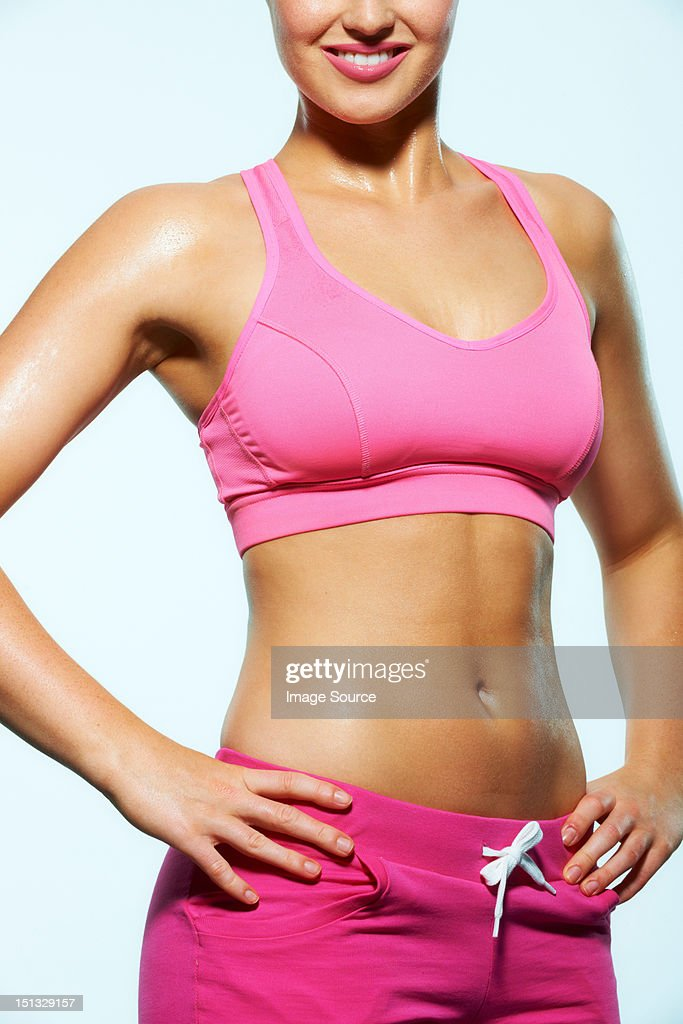 Body of a young woman wearing crop top