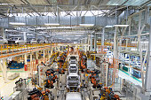body of car on conveyor Modern Assembly of cars at plant. automated build process of car body.