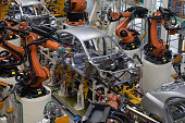 Modern technology of Assembly of cars. The plant of the automotive industry. Shop for the production and Assembly of machines top view. The process of welding parts of the car