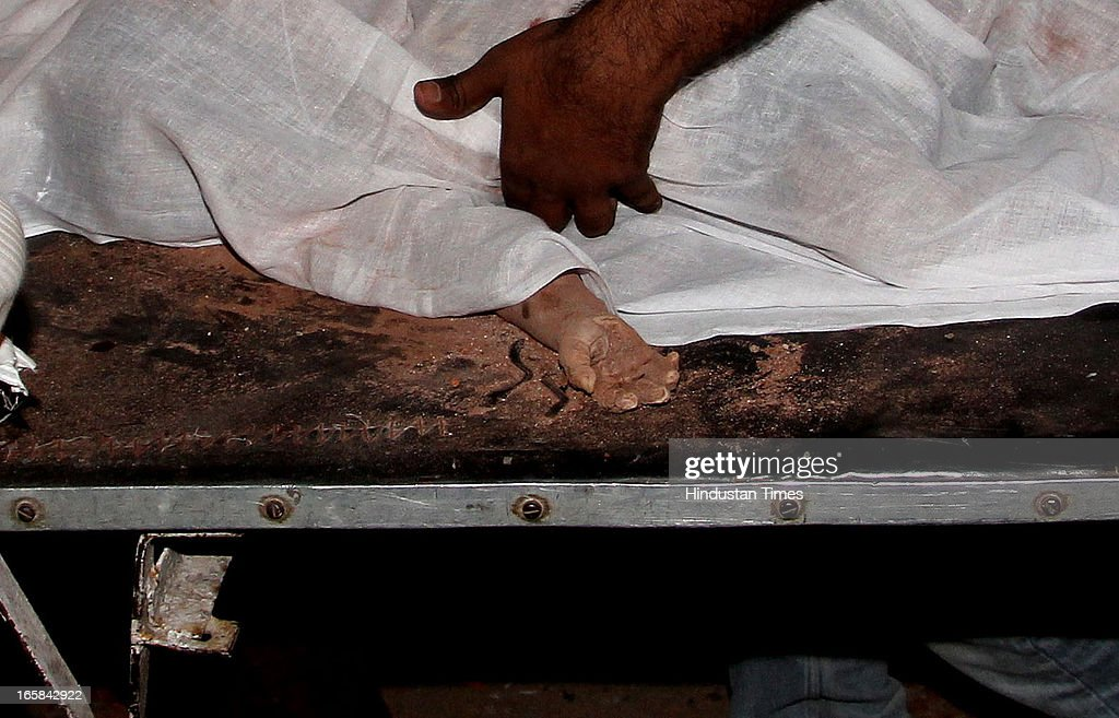 Body of child pulled out of 7-storey illegal structure that caved in here claiming 72 lives on on April 6, 2013 in Thane, India. Rescue operations were called off after 62 people were pulled out of the debris.