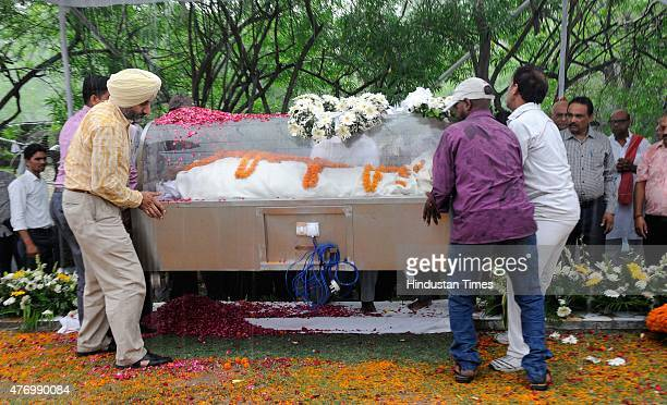 A body of Nek Chand being shifted under a shelter as rain started Creator and Director of the iconic Rock Garden who has amazed people for decades...