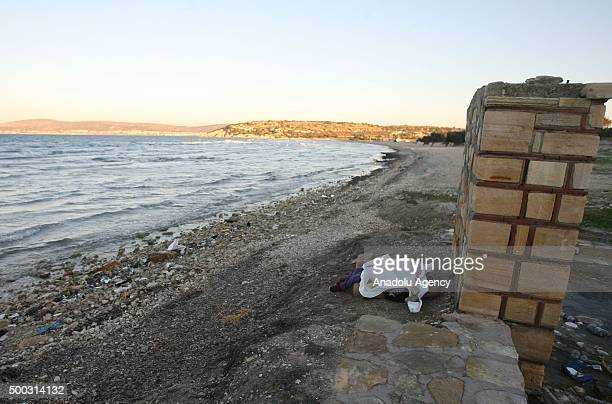 Body of young girl aged 56 is seen after washing up at the shores of Cesme District of Izmir Turkey on December 07 2015