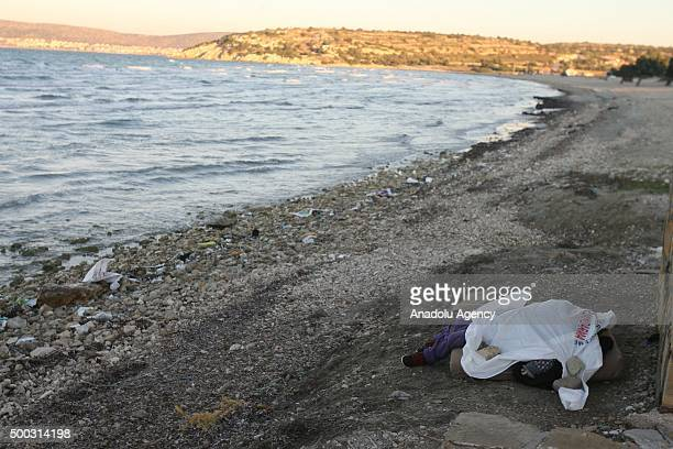 Image contains graphic content Body of young girl aged 56 is seen after washing up at the shores of Cesme District of Izmir Turkey on December 07 2015