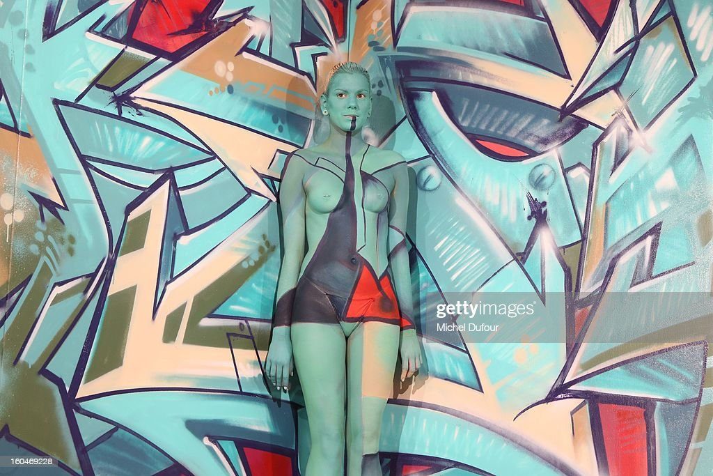 Body Painting Models show at the Make Up For Ever Party at Palais De Tokyo on January 31, 2013 in Paris, France.