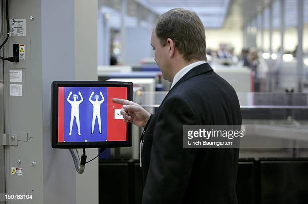 GERMANY HAMBURG Body scanner at the airport Hamburg in trial operation Our picture shows a control person at the monitor of the body scanner