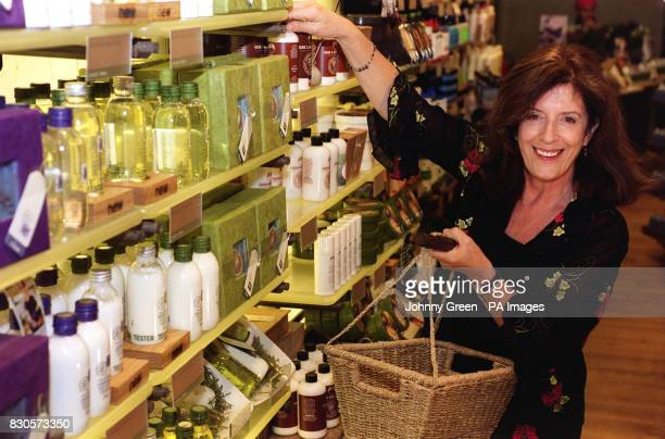 Body Shop founder Anita Roddick as she posed for pictures stacking shelves in her store in High Street Kensington London to mark Body Shop's 25th...
