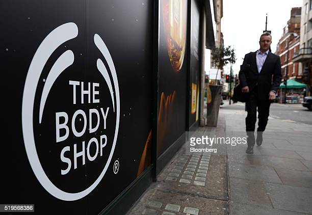 A body shop logo sits on a hoarding outside a Body Shop International Plc store owned by L'Oreal SA in London UK on Thursday April 6 2016 The Body...
