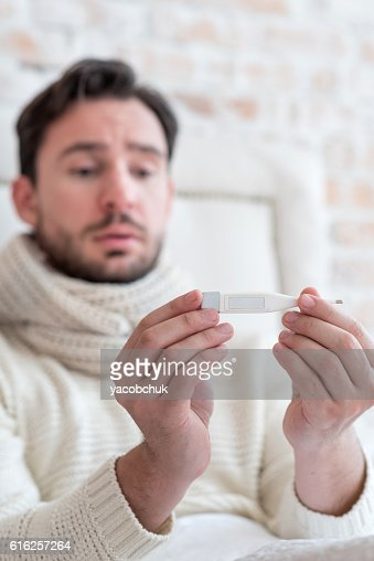 Body thermometer in hands of a man : Foto de stock