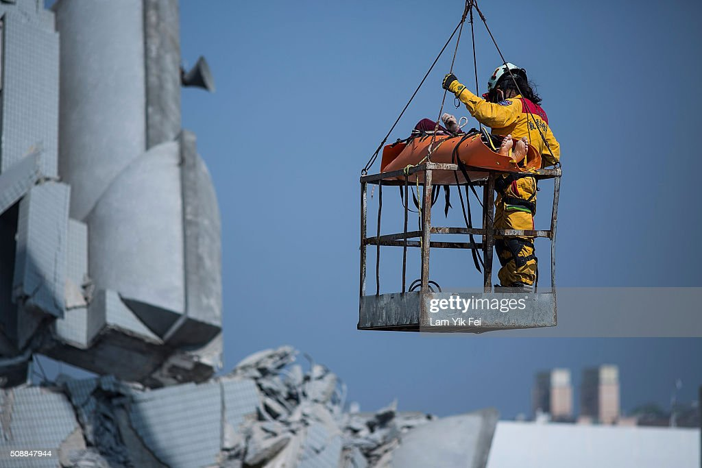 A body transported by rescue worker from a collapsed building on February 7, 2016 in Tainan, Taiwan. A magnitude 6.4 earthquake hit southern Taiwan early Saturday, toppling several buildings, killing at least fourteen people and leaving over one hundred missing in Tainan.