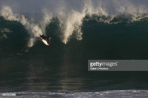 A bodyboarder rides in the tube of a large wave on July 7 2014 in Newport Beach California