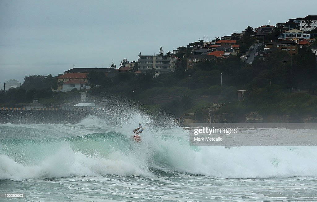 A bodyboarder rides the large swell at Coogee Beach after winds and rain battered Sydney last night on January 29, 2013 in Sydney, Australia. Parts of Sydney are experienced record rainfall after ex-cyclone Oswald swept through the city last night.