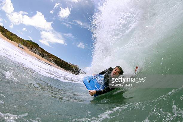 Bodyboarder Riding Powerful Wave