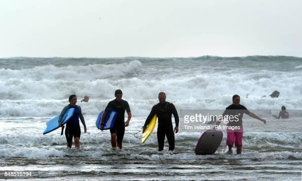 Bodyboarders on Croyde beach during the Bank Holiday weekend