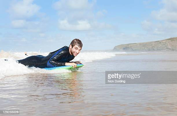 Bodyboarding in the surf