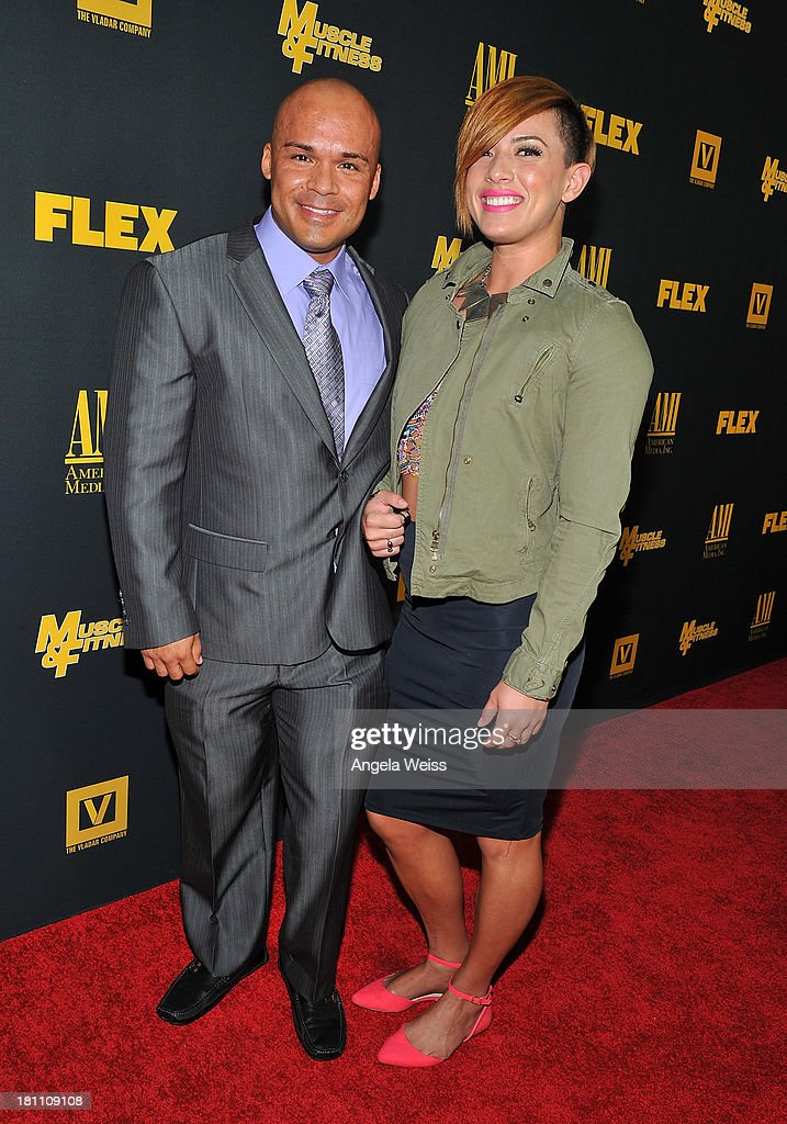 Bodybuilder Branch Warren and guest arrive at the Los Angeles premiere of 'GENERATION IRON' at Chinese 6 Theater Hollywood on September 18, 2013 in Hollywood, California.