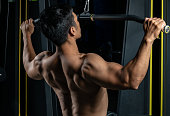Bodybuilder Doing Heavy Weight Exercise For Back