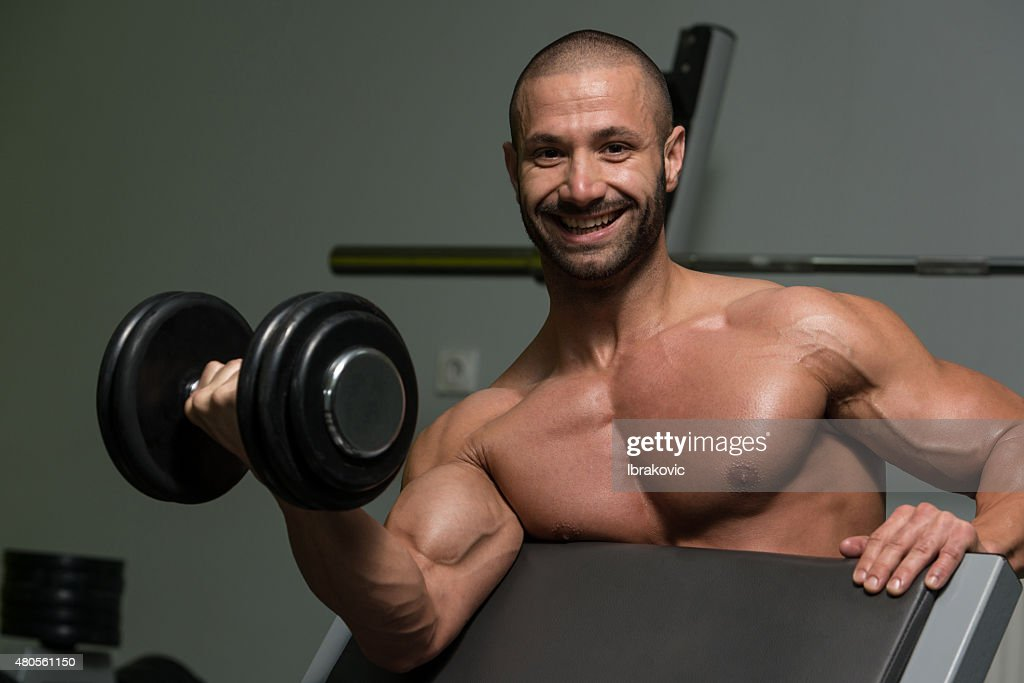 Bodybuilder Exercising Biceps With Dumbbells : Stock Photo