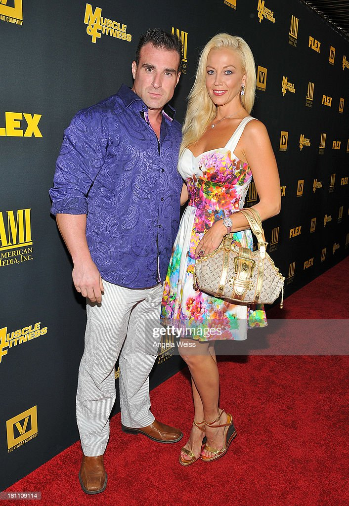 Bodybuilder Kagan Yalaman and actress Liz Fuller arrive at the Los Angeles premiere of 'GENERATION IRON' at Chinese 6 Theater Hollywood on September 18, 2013 in Hollywood, California.