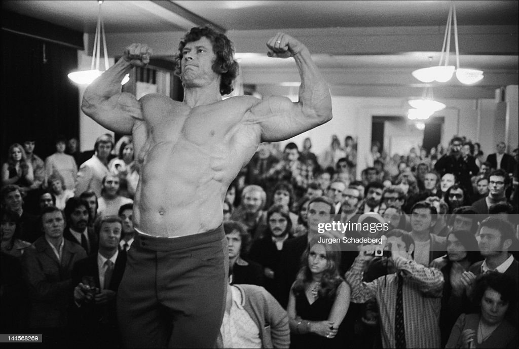 Bodybuilder Paul Grant (1943 - 2003) poses before for the Mr Universe competition at his Victoria Palace, London, 1972.