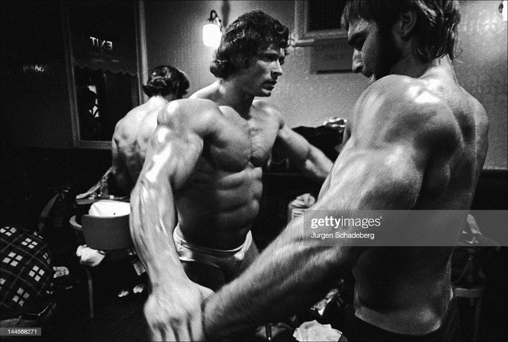 Bodybuilder Paul Grant (1943 - 2003, centre) prepares for the Mr Universe competition, London, 1972.