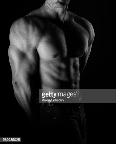 Bodybuilder posing : Stock Photo