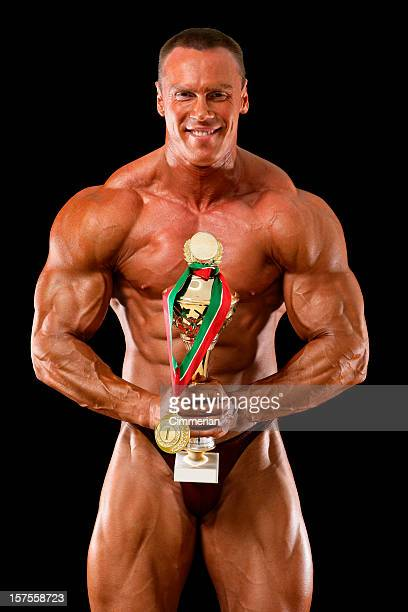 Bodybuilder with gold trophy