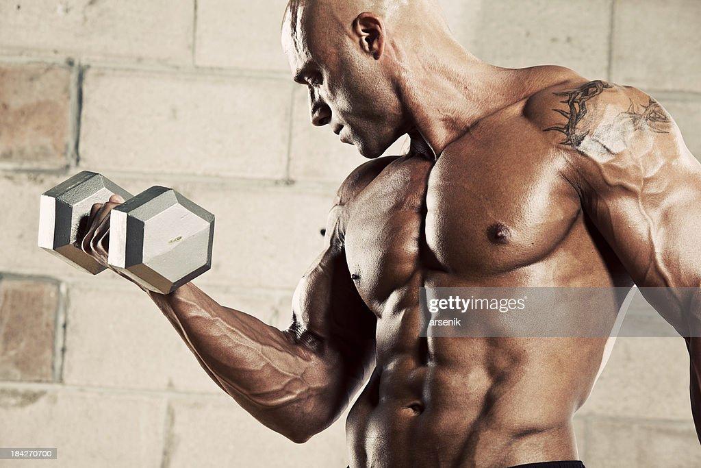 Bodybuilder with weights : Stock Photo