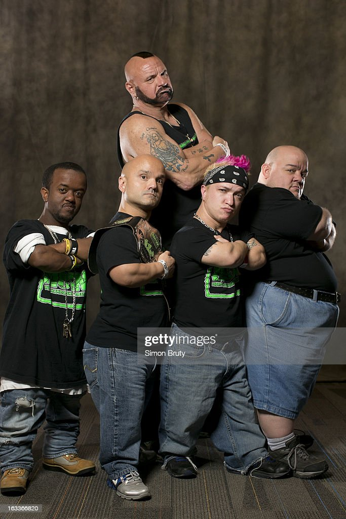 Portrait of Micro Championship Wrestling members (L-R) Huggie Cub (aka Eric Hightower), Short Sleeve Sampson (aka Dan DiLucchio), Sugar James, and Meatball with promoter Johnny 'Attitude' Greene during expo at Greater Columbus Convention Center. Simon Bruty F175 )
