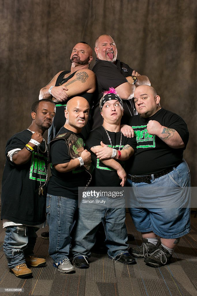 Portrait of Micro Championship Wrestling members (L-R) Huggie Cub (aka Eric Hightower), Short Sleeve Sampson (aka Dan DiLucchio), Sugar James, and Meatball with promoters Big Joe Smarco and Johnny 'Attitude' Greene during expo at Greater Columbus Convention Center. Simon Bruty F190 )