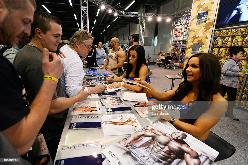 Bodybuilding stars give autographs during the FIBO 2013 on April 14, 2013 in Cologne, Germany.