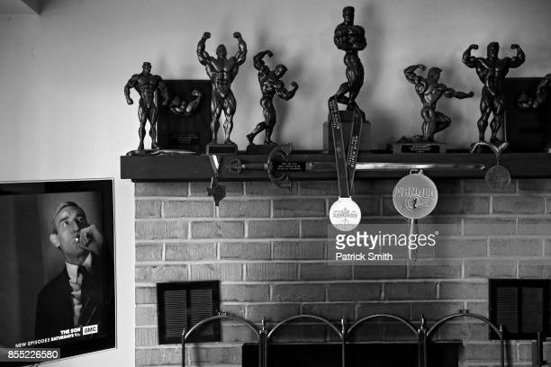 Bodybuilding trophies line the fireplace mantle at the home of IFBB Pro Wheelchair Bodybuilder Johnny Quinn on April 14 2017 in Chesterbrook...