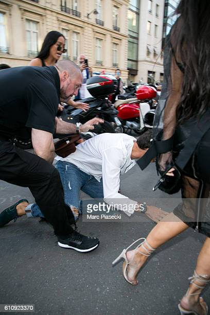 Bodyguard Pascal Duvier immobilizes Vitalii Sediuk after jumping on Kim Kardashian West at 'L'Avenue' restaurant on September 28 2016 in Paris France
